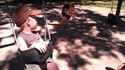boys swinging